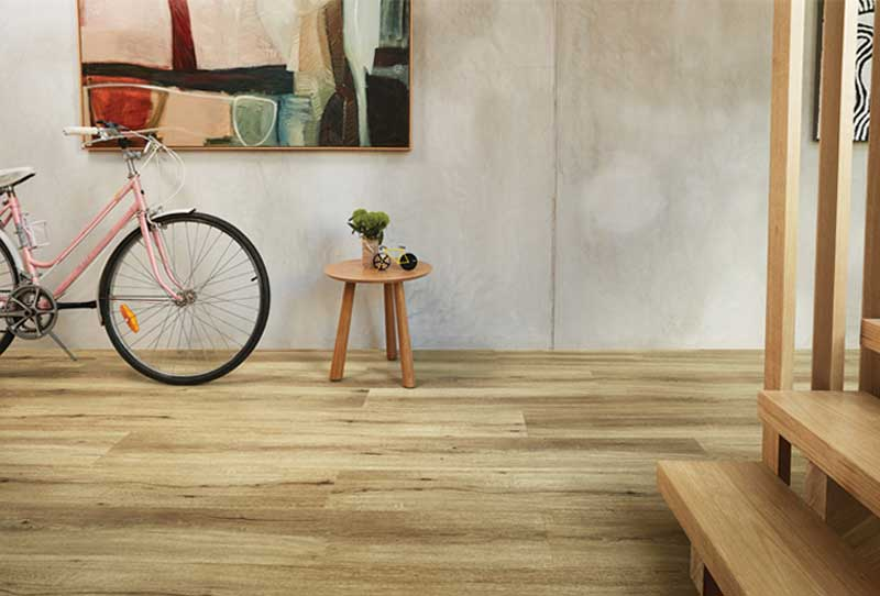 Luxury Vinyl Plank Natural Oak Flooring in Nevada Plain With Staircase and Table